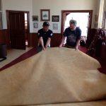 Craig Bryant & Mack McInnes pulling out old carpet